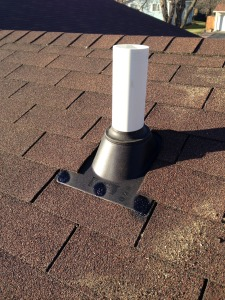 Radon mitigation vent pipe on top a roof.